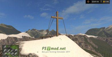 Деревянный крест на горе